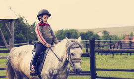Young girl learning to ride Royalty Free Stock Image