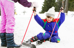 Young girl learning to ski. Getting help royalty free stock image