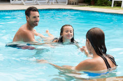 Young girl learning to swim stock images