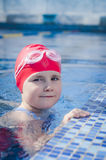 Young girl learning to swim Stock Photos