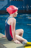 Young girl learning to swim in the pool with flippers royalty free stock photo