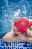 Young girl learning to swim in the pool with flippers royalty free stock images