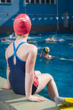 Young girl learning to swim in the pool with flippers Stock Photography