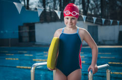 Young girl learning to swim in the pool with foam board Stock Photography