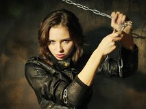 Young girl in leather jacket with chain Stock Photography