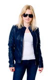 Young girl in a leather jacket and dark glasses. Isolated on a white background Royalty Free Stock Photography