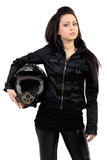 Young girl. The girl in a leather jacket holds a motorcycle helmet in hand stock photos