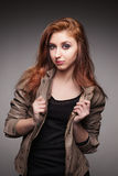 Young girl in a leather jacket represents model Stock Photos