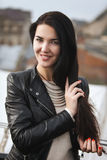Young girl in leather jacket and white pullover Royalty Free Stock Photography