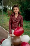 A young girl in a leather Kurta . Stock Photos