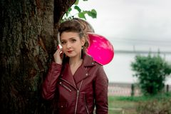 A young girl in a leather Kurta . Stock Image