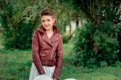 A young girl in a leather Kurta . Stock Photography