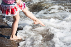 Young girl legs in sea surf Royalty Free Stock Images