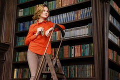 Young girl in the library Royalty Free Stock Photos