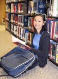 Young girl library reading book Stock Photos
