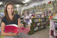 Young girl in library Royalty Free Stock Photography