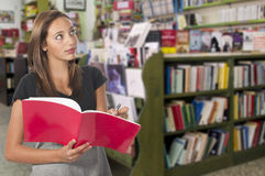 Young girl in library Royalty Free Stock Image