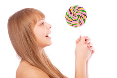 Young girl licks lollipop Stock Images