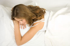 Young girl lie in bed royalty free stock photos