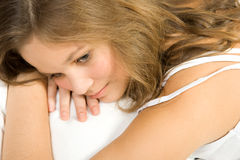 Young girl lie in bed Stock Images