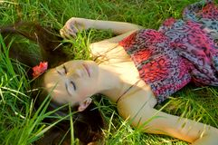 The young girl lies in a grass Stock Images