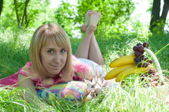 The young girl lies on a green grass Stock Photo
