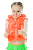 Young girl with lifejacket. Young girl with yellow lifejacket on a white background Royalty Free Stock Photo
