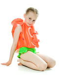 Young girl with lifejacket. Young girl with yellow lifejacket on a white background Royalty Free Stock Image