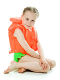 Young girl with lifejacket. Young girl with yellow lifejacket on a white background Stock Photo