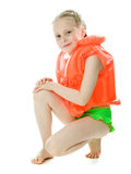 Young girl with lifejacket. Young girl with yellow lifejacket on a white background Stock Image
