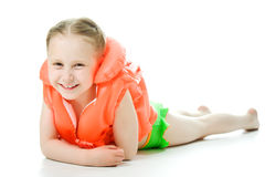 Young girl with lifejacket. Young girl with yellow lifejacket on a white background Stock Photography