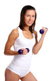 Young girl with lift weights Stock Photo