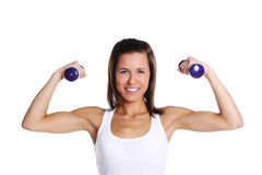 Young girl with lift weights Stock Images