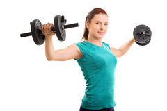 Young girl lifting barbells Royalty Free Stock Images