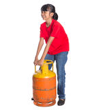 Young Girl Lifting Cooking Gas Cylinder I Stock Photography