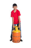 Young Girl Lifting Cooking Gas Cylinder II Royalty Free Stock Images