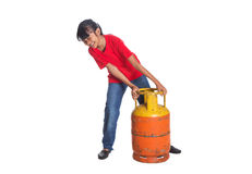 Young Girl Lifting Cooking Gas Cylinder III Stock Photos