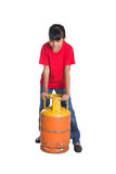 Young Girl Lifting Cooking Gas Cylinder IV Stock Images