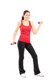 Young girl lifting dumbbells Stock Photo