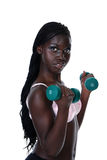 Young girl lifting free weights. Isolated Young girl lifting free weights on a white background Royalty Free Stock Photos