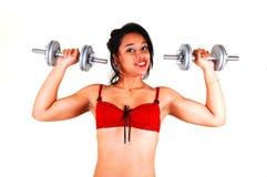 Young girl lifting weight. Stock Photos