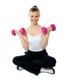 Young girl lifting weights Stock Photo