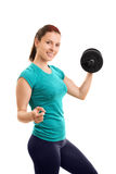 Young girl lifting weights and pointing towards you Stock Photos