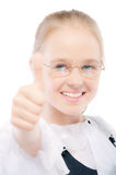Young girl lifts thumb upwards Royalty Free Stock Images