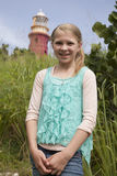 Young girl by lighthouse Royalty Free Stock Images