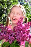 Young girl with lilac flowers. Stock Images