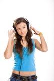 Young girl listen music Stock Photos