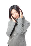 Young girl listen music and close her eyes Royalty Free Stock Photo