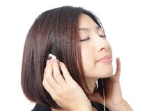Young girl listen music and close her eyes Stock Image