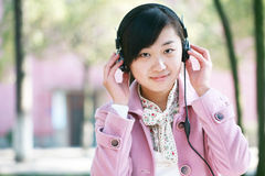 Young girl listen to the music Royalty Free Stock Images